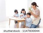 children and teacher at...   Shutterstock . vector #1147830044