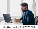 a business man is sitting at ... | Shutterstock . vector #1147870214