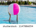 two hands hold inflatable ball | Shutterstock . vector #1147886054