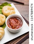 traditional dumpling momos food ... | Shutterstock . vector #1147889474
