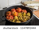 stuffed tomatoes and peppers in ... | Shutterstock . vector #1147892444