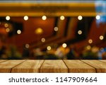 wood table sunset cloud gold... | Shutterstock . vector #1147909664