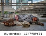 homeless male getting to sleep...