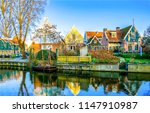 Small photo of River town houses reflection in water landscape. View river town houses scene. River town houses panorama