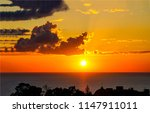 sunset water horizon sky clouds ... | Shutterstock . vector #1147911011