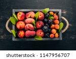 fresh fruits in a wooden box....   Shutterstock . vector #1147956707