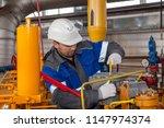 the mechanic   the repairman  ... | Shutterstock . vector #1147974374