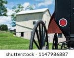 amish buggy wagon wheel on farm   Shutterstock . vector #1147986887