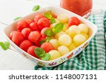 colorful fruit salad.... | Shutterstock . vector #1148007131