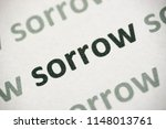 word sorrow printed on white... | Shutterstock . vector #1148013761