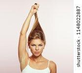 studio portrait of beautiful... | Shutterstock . vector #1148022887