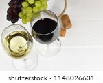 two glasses of red and white... | Shutterstock . vector #1148026631