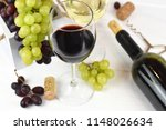 two glasses of red and white... | Shutterstock . vector #1148026634