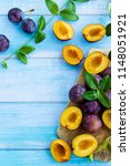 plum slices and whole old worn... | Shutterstock . vector #1148051921