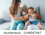 nice family at home. mother and ... | Shutterstock . vector #1148067467