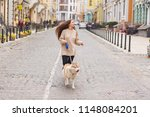 the woman take a walk with... | Shutterstock . vector #1148084201
