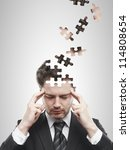 Stock photo head puzzles businessman on a white background 114808654