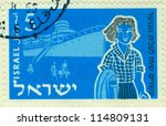 "Small photo of ISRAEL - CIRCA 1955: An old used Israeli postage stamp issued in honor of 20th anniversary of Youth Aliyah with inscription ""Immigration by ship women""; series, circa 1955"
