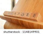 wooden block text of singapore | Shutterstock . vector #1148149901