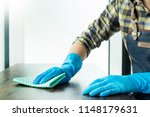 man with cloth cleaning wooden... | Shutterstock . vector #1148179631