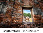 buddha statue in wat...   Shutterstock . vector #1148203874