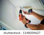 technician installing cctv... | Shutterstock . vector #1148204627