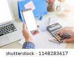 men are calculating work. his... | Shutterstock . vector #1148283617