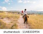horseback riding through the... | Shutterstock . vector #1148333954