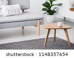 cup on a wooden coffee table... | Shutterstock . vector #1148357654