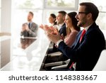 businesspeople applauding while ... | Shutterstock . vector #1148383667