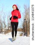 Sport woman running in winter. Female runner portrait in full body jogging in snow on cold winter day. Multiracial Asian Chinese / Caucasian fitness girl. - stock photo