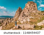 young man at uchisar castle... | Shutterstock . vector #1148454437