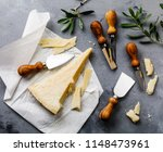 parmesan cheese and knife on... | Shutterstock . vector #1148473961