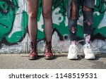 close up legs of two young... | Shutterstock . vector #1148519531
