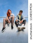 two young adults sitting on top ... | Shutterstock . vector #1148519924