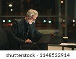 smiling mature businessman... | Shutterstock . vector #1148532914
