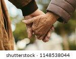 Close Up Of Elderly Couple...