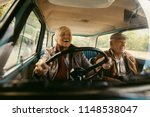 cheerful old couple driving in... | Shutterstock . vector #1148538047