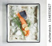 salmon steak on ice with dill... | Shutterstock . vector #1148553827