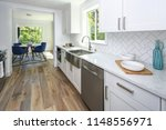 Stock photo remodeled kitchen with pure white cabinets marble countertops herringbone backsplash and wide 1148556971