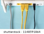connect an ethernet cable to a... | Shutterstock . vector #1148591864