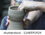 artisan hands making clay pot... | Shutterstock . vector #1148591924