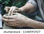 artisan hands making clay pot... | Shutterstock . vector #1148591927