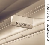 vintage tone emergency exit... | Shutterstock . vector #1148674541