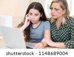 mother comforting daughter... | Shutterstock . vector #1148689004