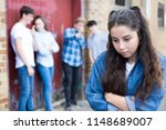 unhappy teenage girl being... | Shutterstock . vector #1148689007