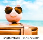 piggy bank wearing sunglasses...