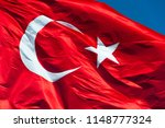 turkish flag waving in sky.... | Shutterstock . vector #1148777324