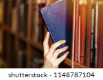 researching irs tax code | Shutterstock . vector #1148787104