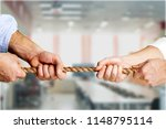 Business People Pulling Rope I...